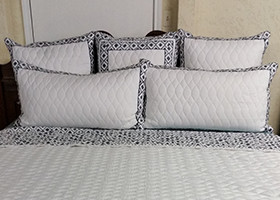 White and Navy Quilted Pillows And Bedding